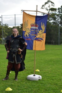 Lysa standing by flag